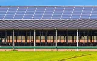 Solar panels on the rooftop of a farm building
