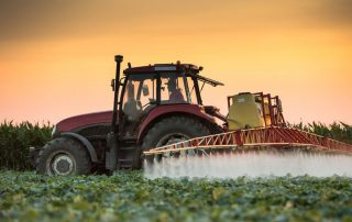 Tractor spraying a crop